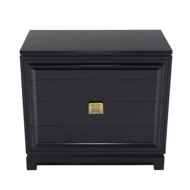James Mont style black lacquer four-drawer bachelor chest. The piece is from the mid 20th century.