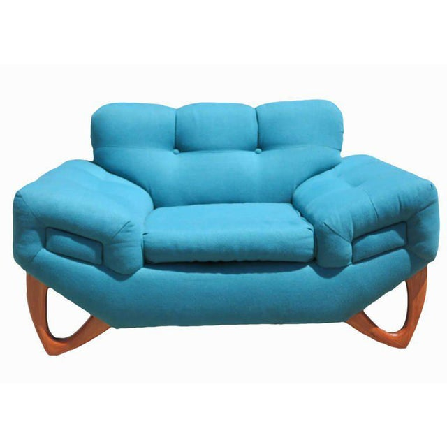 This Mid-Century Modern lounge chair is upholstered in its original turquoise fabric and features a tufted back and...