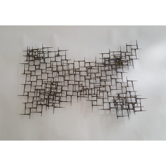 Sculpture is made of vintage cut masonry nails welded together with bronze. It is a multi-dimensional, layered piece. This...