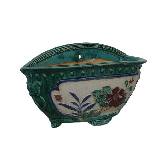 This is a handmade ceramic planter with half round shape and decent oriental accent. The surface is dimensional oriental...