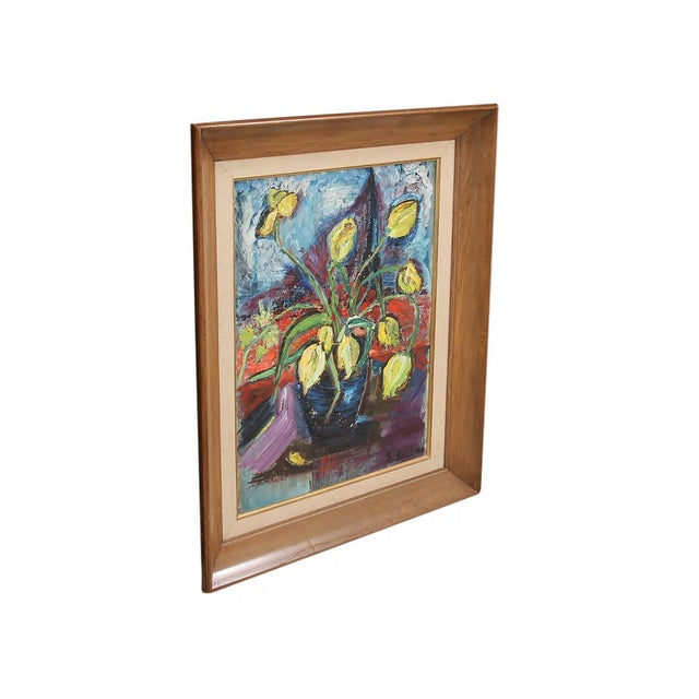 A mid century oil on board still life painting. A colorful impressionist still life of yellow tulips. Set in a solid wood...