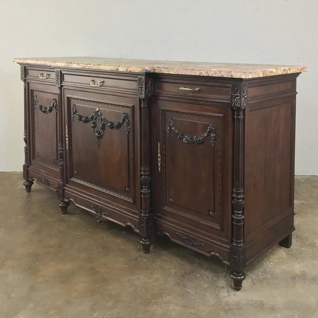 19th Century French Walnut Louis XVI Marble Top Buffet represents the epitome of the genre, with the obvious talents of...