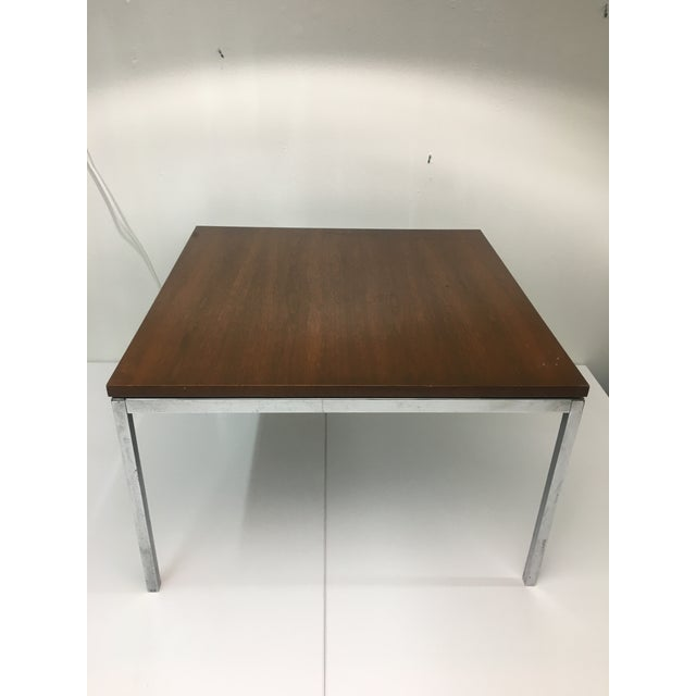 Structurally stable, strong and sturdy iconic table designed by Florence Knoll, 1950s. Heavy chrome base with floating top...