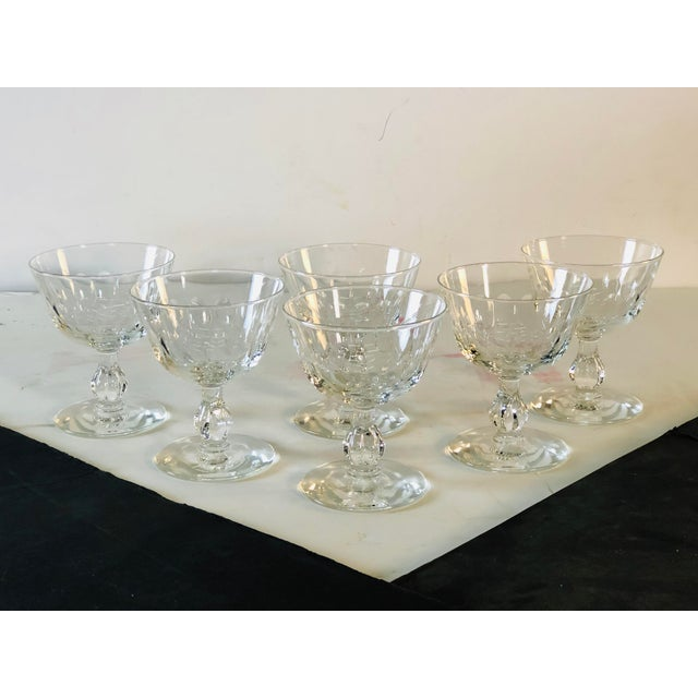 1950s set of 6 mitred glass coupe stems. All hand cut and polished. No marks. Excellent condition.
