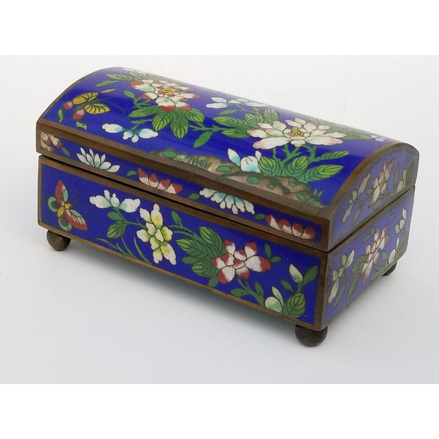 Antique Chinese Cloisonne footed hinged box with floral motif and rounded lid ,circa 1920. Interior and base is blue...