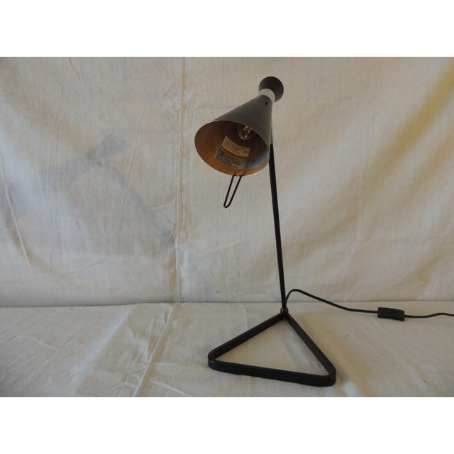 Mid-Century Modern Style Black Metal Desk Lamp with articulated head. Gold finished color inside cone head lamp. Cloth...