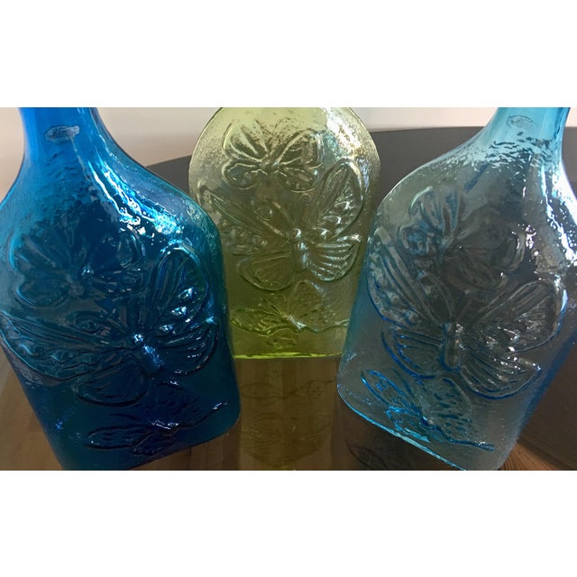 "Three Architectural Blenko butterfly decanters handblown at ""The Festival of Glass"" in 2013 by Blenko artists. These are..."