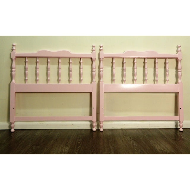 In baby girl pink lacquer finish twin headboards. A pair! They are in great condition. They style is country/Colonial with...