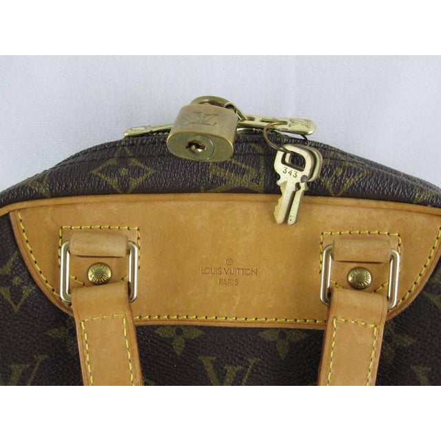 A vintage, iconic LV monogram Louis Vuitton Excursion travel shoe bag along with the original padlock, two keys and the...