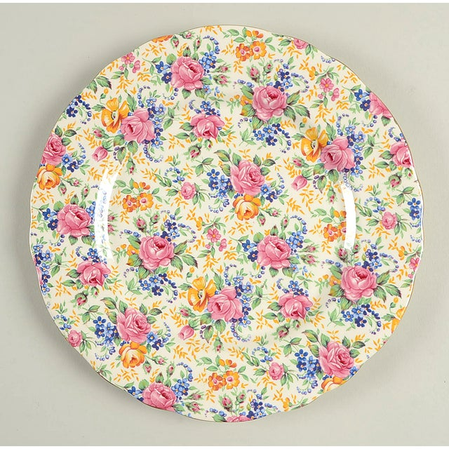 James Kent Rosalynde Luncheon Plate Set/6 features all over chintz floral design in pink, blue, and yellow with gold trim....