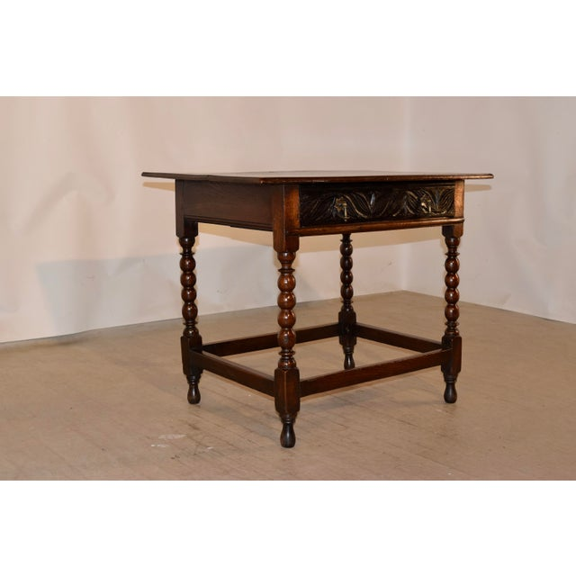 18th century English side table made from oak. The top has a beveled edge around the top, which has lovely graining...