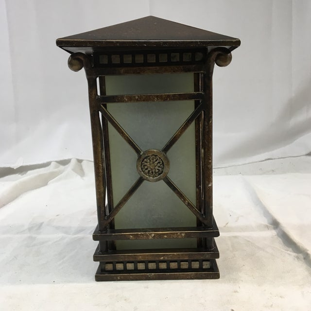 The details of this unique outdoor wall sconce evoke Grecian architecture and design. In excellent condition. Comes with a...