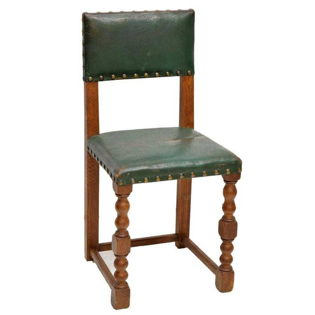 Classic and contemporary leather Renaissance Revival style oak side chairs. Each chair is upholstered green leather back...