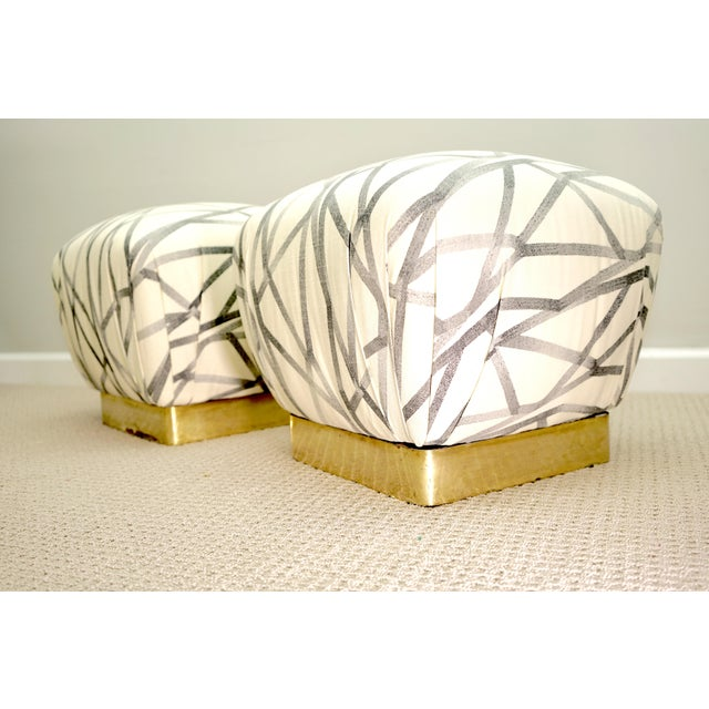 Fun pair of marge Carson poufs. There is no makers tag, however, as these have been reupholstered a few times. There is...