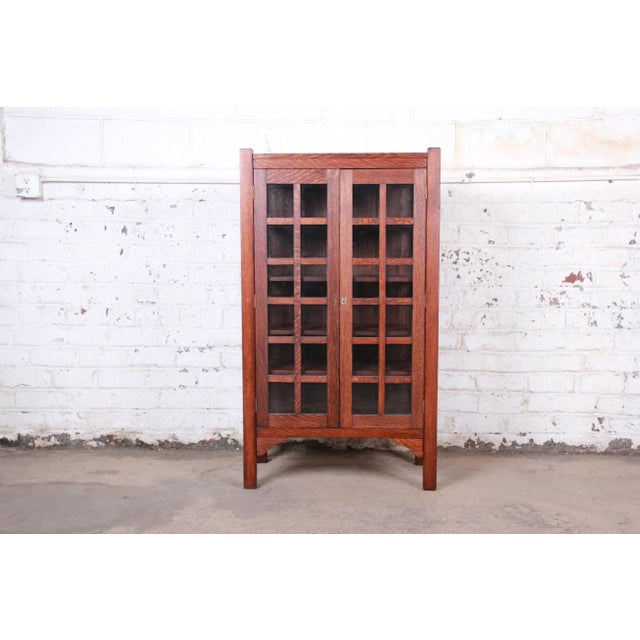 An exceptional Gustav Stickley style Arts & Crafts period quartersawn oak bookcase. The bookcase features gorgeous solid...