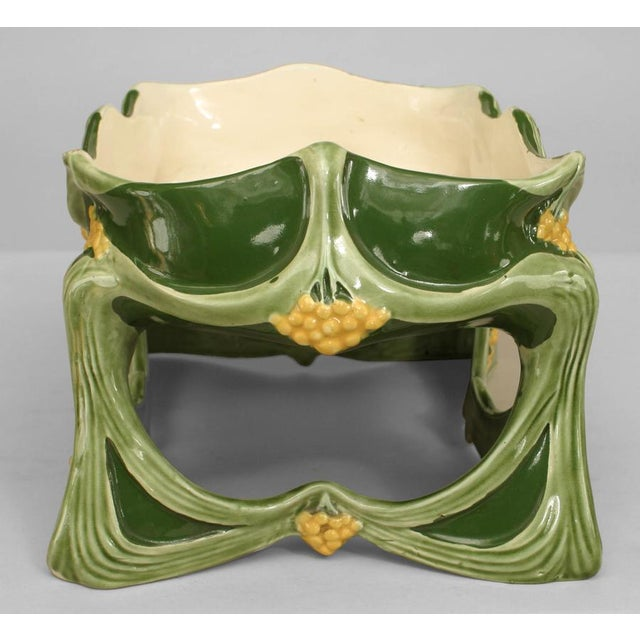 French Art Nouveau light & dark green porcelain rectangular shaped centerpiece with yellow floral trim and raised on an...