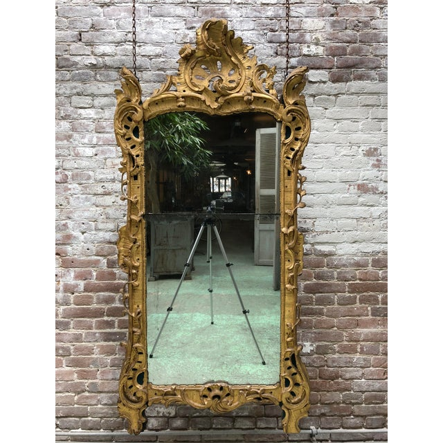 Magnificent French carved gilt wood mirror, Louis XV. Provenance private collection France. This Louis XV mirror, due to...