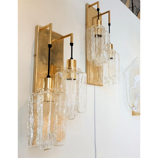 Pair of brass & Murano hand blown textured clear glass wall sconces. 2 lights each, rewired with black thick wire,...
