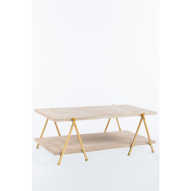"""New wood table with metal details. More than 1 available. Measurements:47.5""""l x 25.5""""d x 18""""h Materials: Metal, wood"""