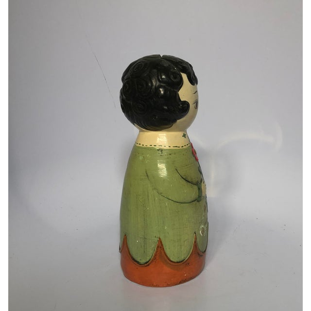 Hand-painted vintage Paul Marshall pottery piggy bank in the image of a woman in folk-style clothes. Looks to be Made in...