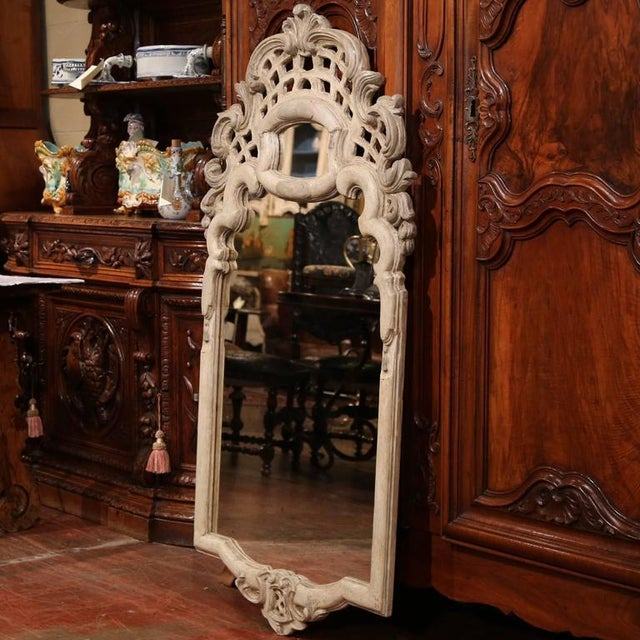 Heavily hand-carved painted mirror from Italy, circa 1920. Hand painted with grey and off-white finish. Excellent condition.