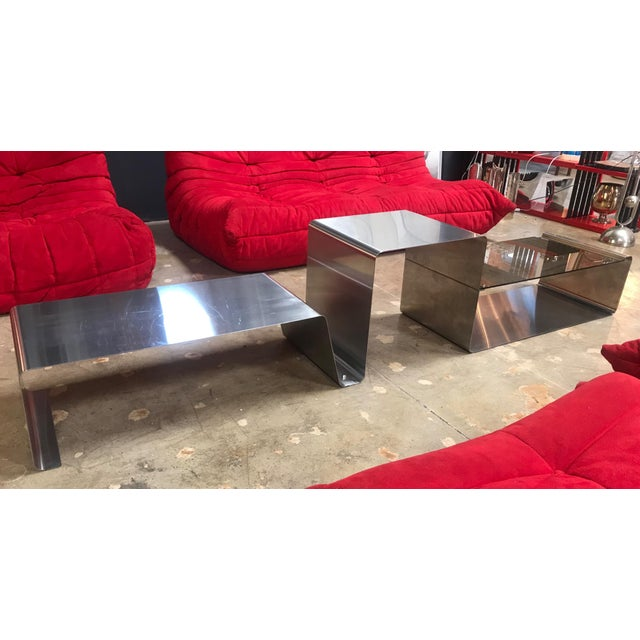 This rare and unique coffee table is made of three modular pieces: two in chrome metal and one with a glass top. Unique...