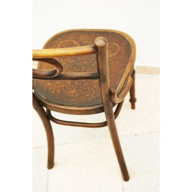 This chair originates from Austria in the 1890s. It is made of bentwood and beech and is atrributed to Thonet Brothers....