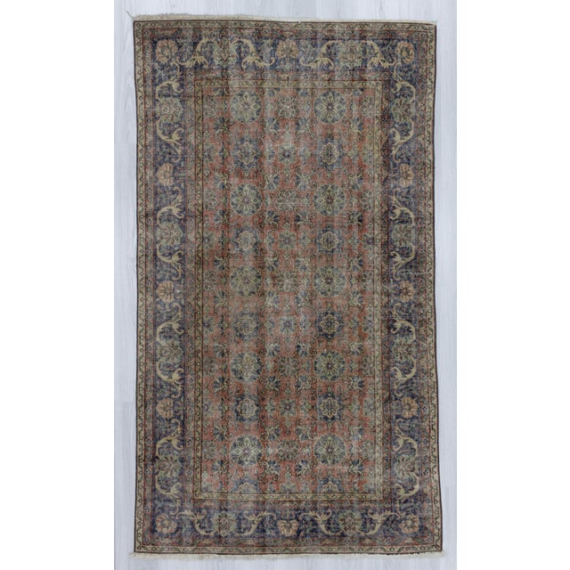 Vintage hand knotted rug from Isparta region of Turkey. In good condition. Approximately 50-60 years old.