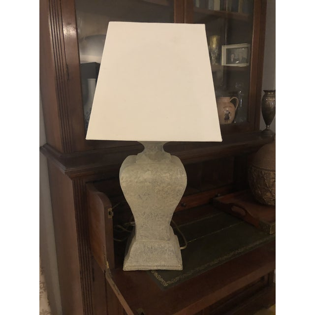 This is one of those pieces that fits in anywhere. The lamp is made of plaster to look like concrete. It's size and shape...