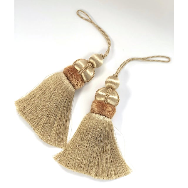 Pair of gold colored key tassels with hand cut velvet ruche, decorative gimp and twisted cord detail. **Please note:...