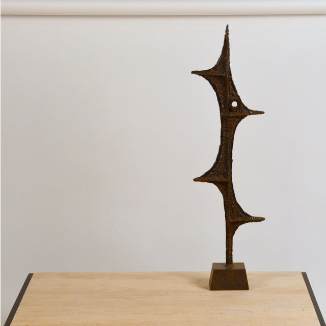 Tall Brutalist studio sculpture by John De La Rosa. Signed. The last image shows a similar sculpture in an interior...
