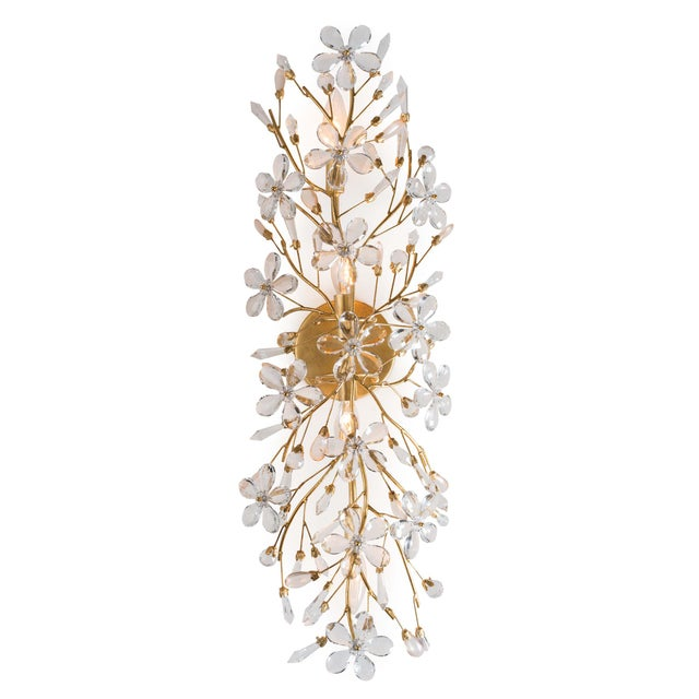 Delicately crafted crystal flowers suspended by gold frame, gives this sconce a strikingly romantic feel. The hand-...