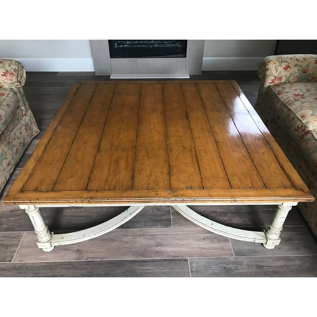 A square, custom coffee table by Guy Chaddock. This piece features a square wood table top with baluster legs, and curved...