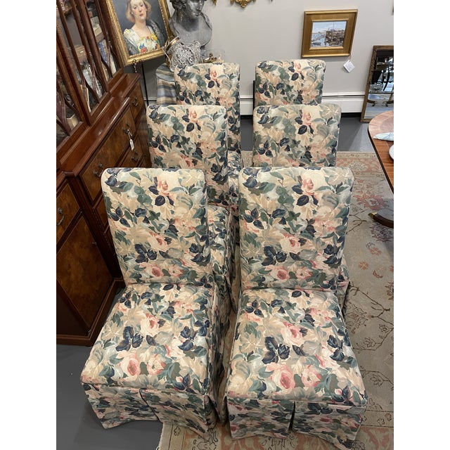 A set of 4 lovely side chairs with pretty bow detail in back. The chairs are vintage they have a floral pattern fabric.