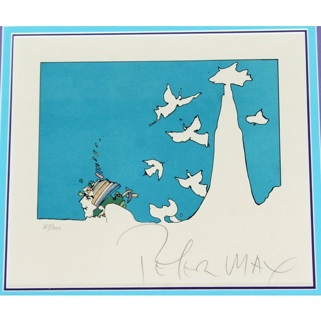 """For your consideration is a framed, original numbered lithograph by Peter Max, signed, entitled """"Winters Dream,"""" 87/300...."""