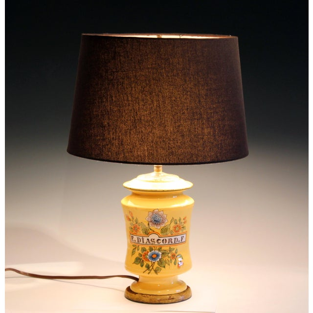 Antique French pottery albarello form faience lamp, circa early 20th century. Diascord was a pre-modern potion to ease...