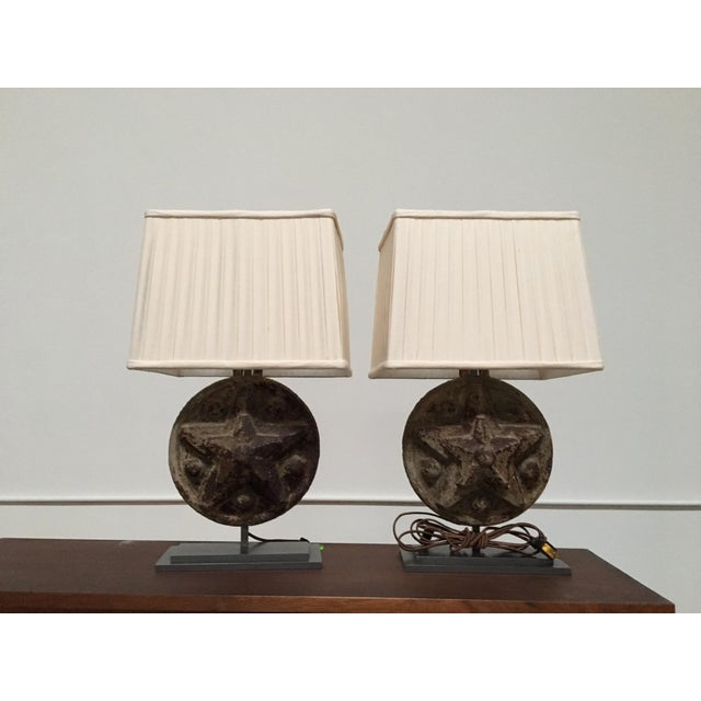 A wonderful pair of Antique Iron Star Table Lamps circa 1860. Comes with two off-white lamp shades that work perfectly...