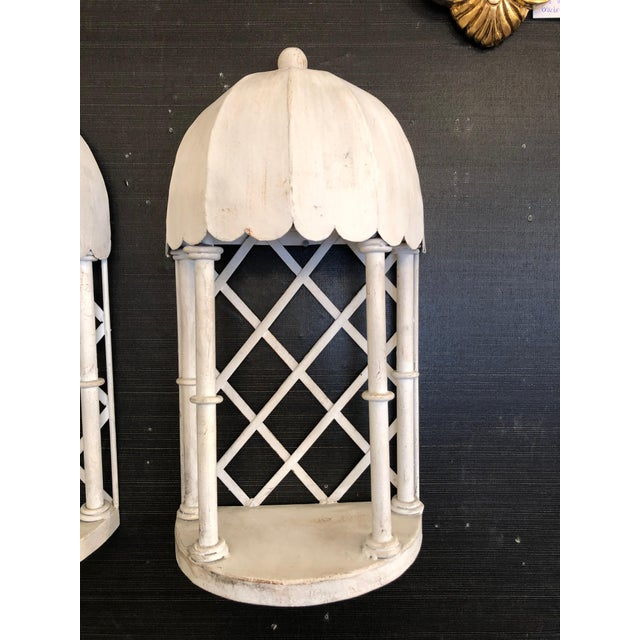 Super stylish pair of white painted iron and tole wall brackets that bring to mind Palm Beach pools and gardens, having...