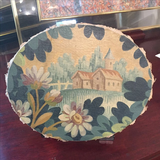Charming early 20th Century Continental oval oil on canvas of a floral landscape with a cathedral in the background....