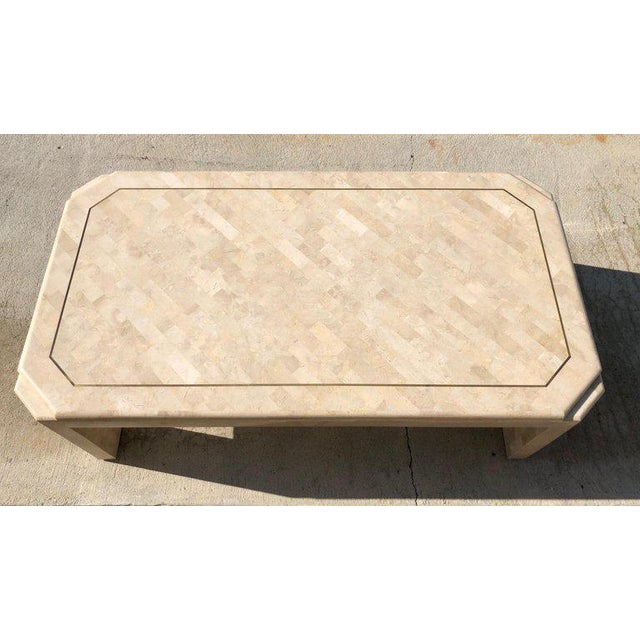 A Glamorous 1980s tessellated fossil stone with aged brass inlaid design by Maitland Smith. The table has been newly...