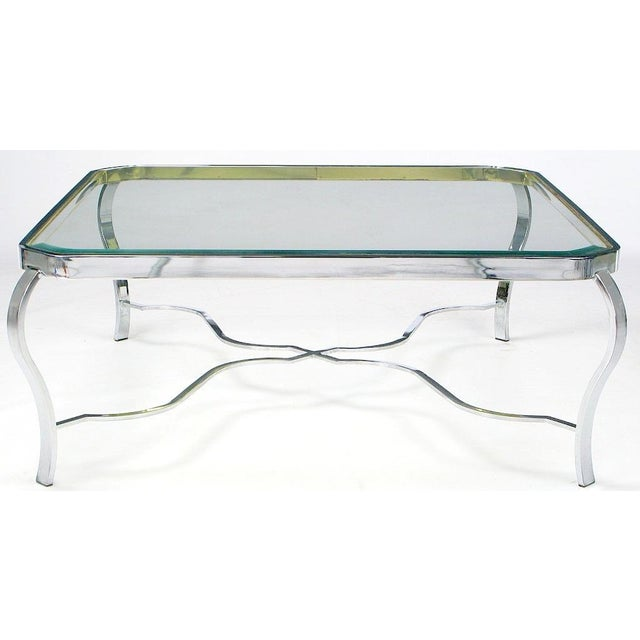 Quite possibly Milo Baughman, this coffee table has a neoclassic design combined with the metals of choice for the 70s....