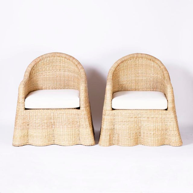 Lofty pair of wicker drapery ghost arm chairs with a casual elegance crafted with a sturdy metal frame ambitiously wrapped...