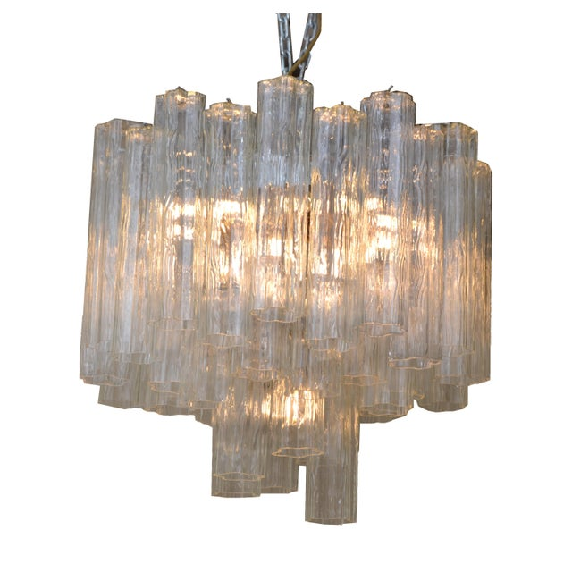 Mid-Century Modern Italian round three tier tronchi glass and chrome chandelier with brass sockets. Comes with a chain and...