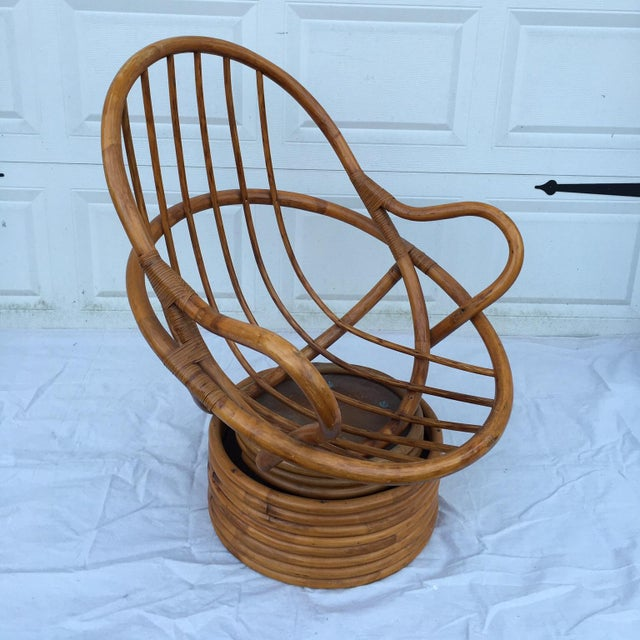 Vintage rattan swivel chair; very comfortable. Minimal, age-related wear. Pillows not included.