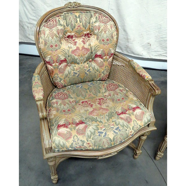 Pair of Louis XVI style bergere chairs with caned seats, backs and sides.