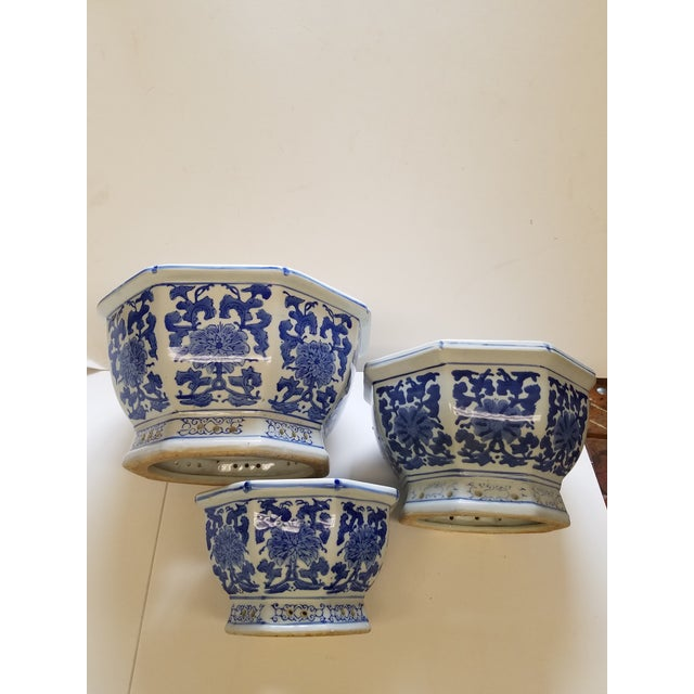 A set of 3 Chinese flower pots or cachepots. Great vintage set from a local estate. 3 Octagonal Pots with drainage hole....