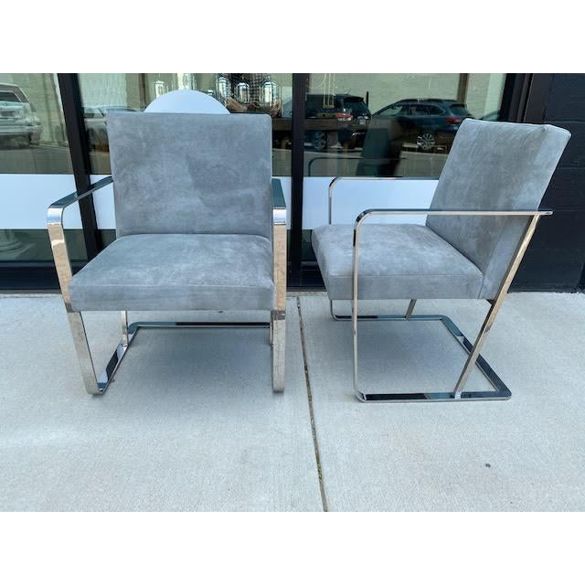 Fabulous pair of mid-century chrome chairs, newly recovered in suede upholstery. A truly stunning pair with great vintage...