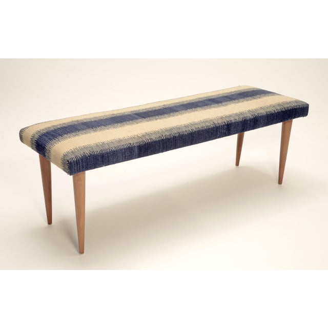 comfortable tapered wood legs bench, covered in high quality hand woven and vegetable dyed authentic wool Kilim. Made in...