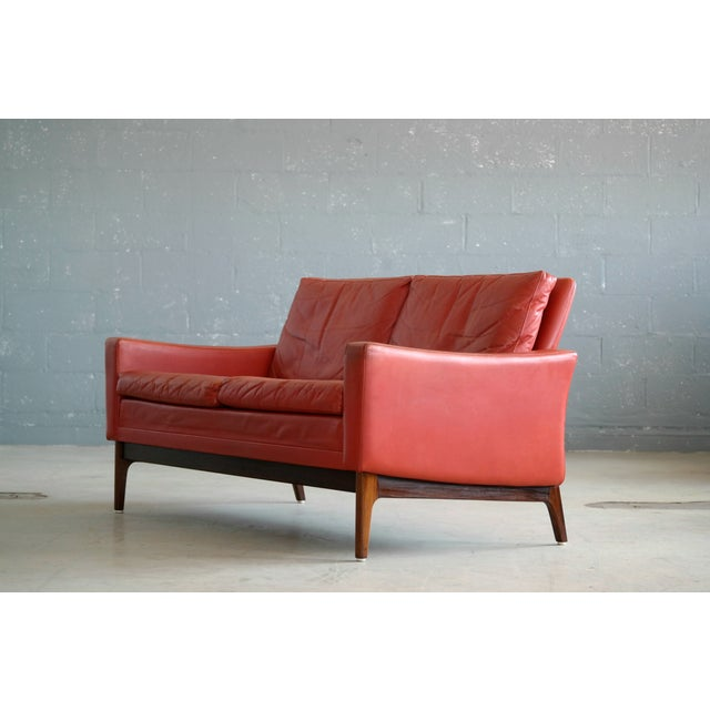 Animal Skin Classic Danish Mid-Century Modern Sofa in Red Leather and Rosewood Base For Sale - Image 7 of 11