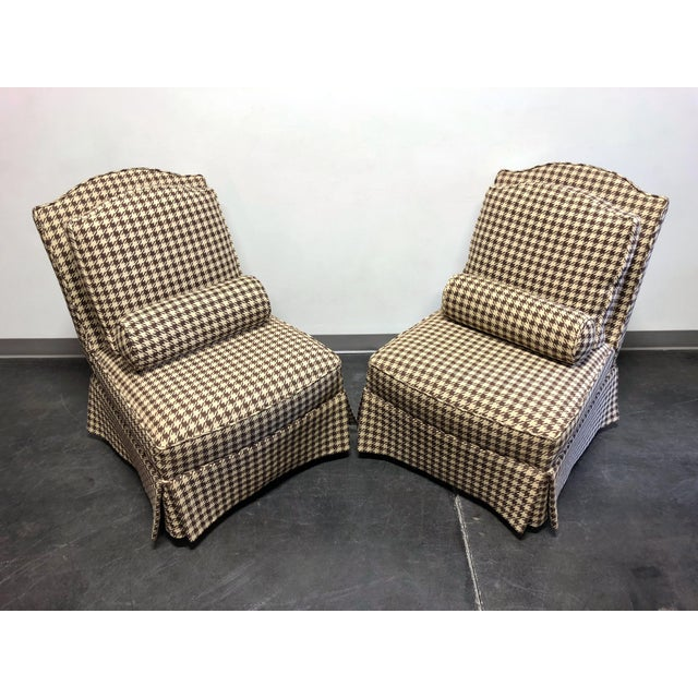 A pair of slipper chairs by Theodore Alexander of Hickory North Carolina, USA from their Althorp Living History line. Made...
